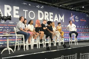 Michael Rice (centre) with his backing singers and PR team during a press conference at the Expo Tel Aviv in Israel.