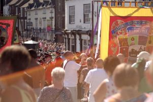 Banners being marched through the streets of Durham City.