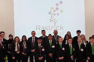 Secretary of State for Education Gavin Williamson CBE MP (centre) with Craig Whittaker, Rastrick High School pupils and head teacher, Steve Evans
