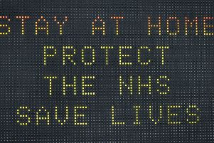 A matrix road sign on the A367 into Bath advises motorists to stay at home to protect the NHS and save lives the day after Prime Minister Boris Johnson put the UK in lockdown to help curb the spread of the coronavirus. Photo: Ben Birchall/PA Wire