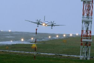 STORM DORIS: A plane struggles to land at Leeds Bradford Airport. PIC: Tony Johnson