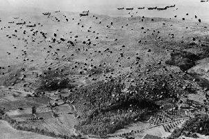 Paratroopers landing in Normandy on D-Day.