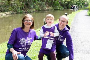 Gabriella, Calvin and Carl Walker, walking from Sowerby Bridge to Hebden Bridge, raising money for the Forget Me Not Childrens Hospice earlier this year