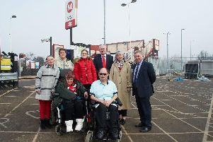 At the front: Damon Nicholson and his cousin Stephanie Downes are unable to use one of Pontefract Monkhill's platforms because there is no step-free access. 'At the back from left to right are Damon's sister Mary Nicholson, Stephanie's sister-in-law Susan Smith, Damon's father's partner Karina Nicholson and Pontefract councillors Clive Tennant, Pat Garbutt and David Jones.