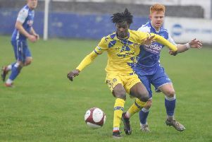 Frickley Athletic debutant Ollie Valentine stays strong to hold up a Spalding United attack. Picture: Onion Bag Photos