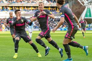 Goal celebration: Ezgjan Alioski celebrates scoring for Leeds United at Huddersfield Town.