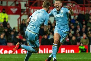 Liam Cooper celebrates his goal against Brentford with Kalvin Phillips. Picture: Bruce Rollinson