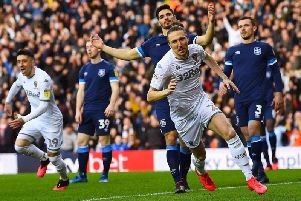 Luke Ayling turns to celebrate his goal for Leeds United against Huddersfield Town. Picture: Jonathan Gawthorpe