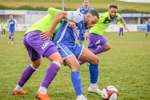 Frickley Athletic's Tyler Williams stays strong in the tackle to thwart a Kidsgrove attack. Picture: Onion Bag Photos