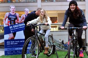 170118  Olympic Triathlete Lucy Hall takes on  Sophie Chapman, 10, in the triathlon challenge at Trinity Leeds on saturday .