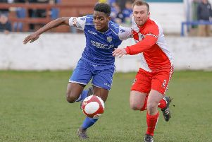 Frickley Athletic forward Miracle Akafor is too strong for a Gresley defender. Picture: Onion Bag Photos