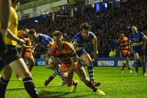 Greg Eden goes over for the opening try for Castleford Tigers at Warrington Wolves. Picture: James Heaton
