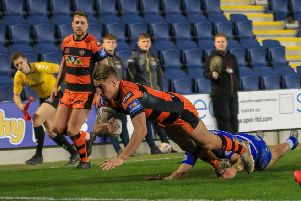 Greg Minikin dives over for a try for Castleford Tigers at Leeds Rhinos. Picture: Simon Hall