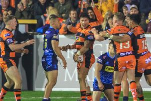Mitch Clark celebrates his try with Castleford Tigers teammates. Picture: Simon Hall