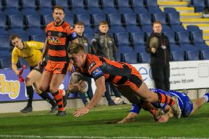 Greg Minikin dives over for a try in Castleford Tigers' game against Leeds Rhinos.
