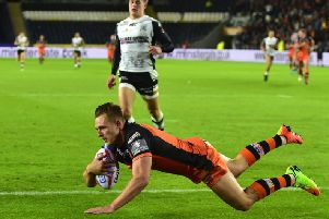 Castleford Tigers' Greg Eden dives over for a try on a previous game at Hull.