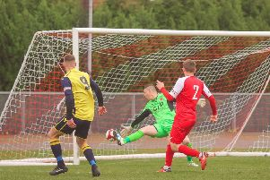 Tyler Walton scores for Frickley Athletic at AFC Mansfield. Picture: Onion Bag Photos