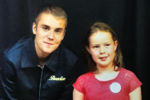 Ruby Varley pictured aged seven when she met  Justin Bieber