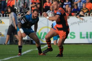 Liam Watts on the attack for Castleford Tigers against Leeds Rhinos. Picture: Simon Hall