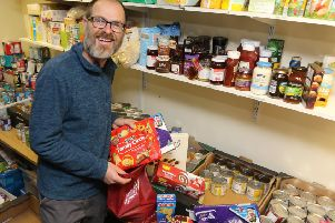 Food bank coordinator Ed Rippon appealing for items to fill their Christmas bags