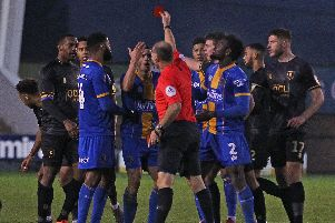 Referee Andy Haines shows a red card to Shrewsbury's Oliver Norburn.