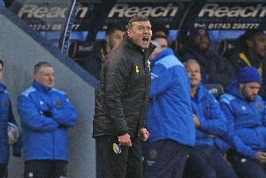 Mansfield boss John Dempster on the touchline at Shrewsbury.