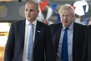 Prime Minister Boris Johnson, walks with Northern Powerhouse minister Jake Berry during a visit to Doncaster Market in September 13. Photo: Jon Super - WPA Pool/Getty Images