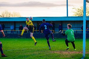 Joe Butler gets a header in which would be cleared off the line by defender Chris Timons (no.5). All photos: Lee Fox Photography.