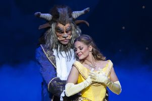 Belle and the Beast. Photo courtesy of Whitefoot Photography