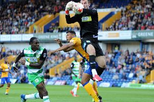 Mansfield Town v Yeovil Town.    'Matt Green and Yeovil's Nathan Smith are beaten to the ball by 'keeper ArturKrysiak.