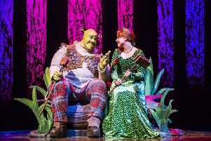A scene from Shrek, The Musical featuring Shrek and Princess Fiona. Photo by: Tristram Kenton