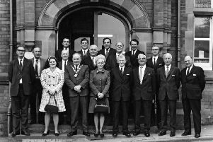 1970: This fabulous nostalgic shot features Hucknall urban district councillors and officials outside Hucknall Library, Market Place. Picture courtesy of Nottinghamshire Archives.