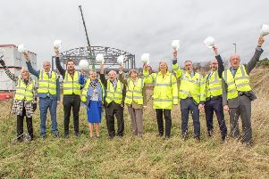 Councillors and council officers join representatives of Flying High Academy to celebrate the start of work on the new school.