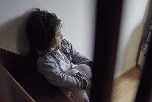 The charity is urging the government to recognise children living with domestic abuse as victims under law. Photo - NSPCC