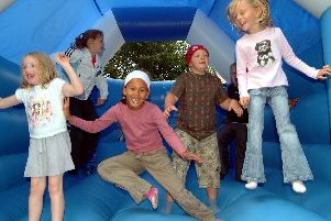 2007: This bouncy bunch are enjoying the bouncy castle at the Saplings Summer Play Scheme fun day at St Peter and St Paul Church in Hucknall. Spot anyone you know?