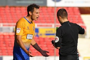 Picture by Gareth Williams/AHPIX.com; Football; Sky Bet League Two; Swindon Town v Mansfield Town; 20/10/18  KO 15:00; The Energy Check County Ground; copyright picture; Howard Roe/AHPIX.com; Mansfield's Will Atkinson pleads with referee Antony Coggins as he gives him a second yellow card at Swindon