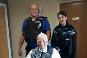 Retired Inspector John Fletcher with officers from Bulwell police station