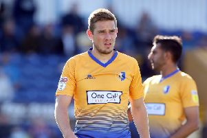Timi Elsnik in Mansfield Town action.