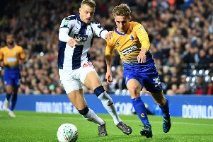 WEST BROMWICH, ENGLAND - AUGUST 28:  Kyle Howkins of West Bromwich Albion battles for possession with Danny Rose of Mansfield Town during the Carabao Cup Second Round match between West Bromwich Albion and Mansfield Town at The Hawthorns on August 28, 2018 in West Bromwich, England.  (Photo by Clive Mason/Getty Images)