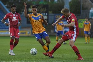 Picture: Andrew Roe/AHPIX LTD, Football, Carabao Cup First Round, Mansfield Town v Morecambe, One Call Stadium, Mansfield UK, 13/08/19, K.O 7.45pm''Mansfield's Alistair Smith dribbles away from Morecambe's Steven Old'Howard Roe>>>>>>>07973739229