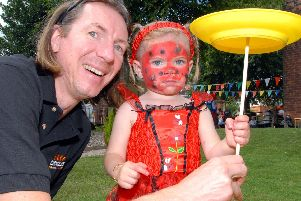 2010: Andy Vass of TheCircusWorkshop.com is pictured with Jaydee Neal who seems to be doing a great job of spinning the plate. This fabulous snap was taken at St Marys Church summer fair in Newstead. Did you go to this event?