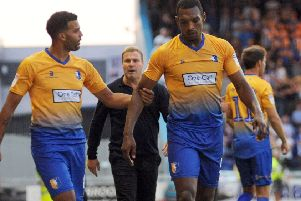 Krystian Pearce is led away from trouble at the end of the Wednesday fracas.