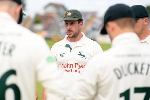 Steven Mullaney speaks to his Notts team-mates
