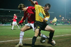 Harrad tussles with Manchester United's Gerard Pique whilst playing for Burton Albion.