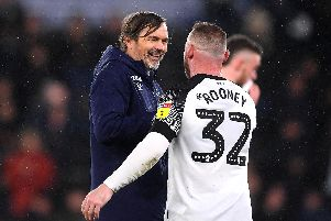 Phillip Cocu, manager of Derby County, celebrates victory with Wayne Rooney. Photo by Laurence Griffiths/Getty Images.