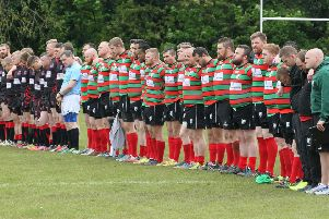 The players from both sides stand for a minutes silence in respect of Danny Jones -Pic by: Richard Parkes