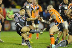 Rangi Chase, left, in action against former club Castleford.