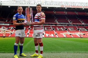 Leeds Rhinos captain Kevin Sinfield, left, and Wigan Warriors captain Sean O'Loughlin, holding the Super League trophy ahead of the 2015 Grand Final.