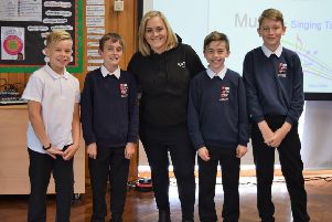 Katie Markham spent three hours at Ilkeston's Chaucer Junior School performing a host of the Grammy award-winning singer's hits as well as a question and answer session with pupils.