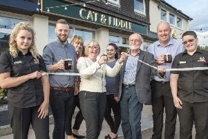 Maggie Throup MP is pictured with Coun John Frudd and general manager Dale Morby at the opening of the newly refurbished pub with staff.